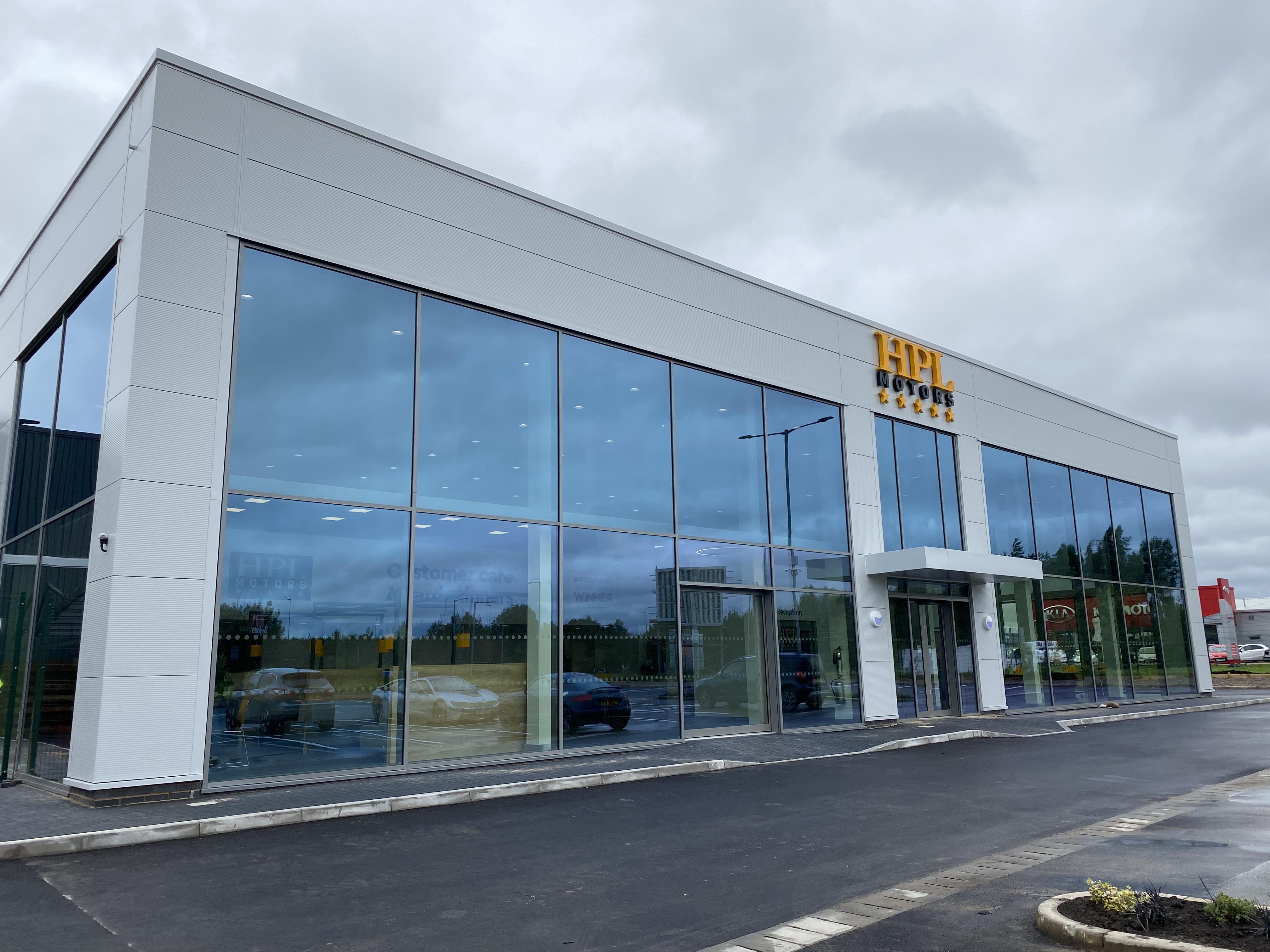 the front exterior of a HPL Motors Car showroom