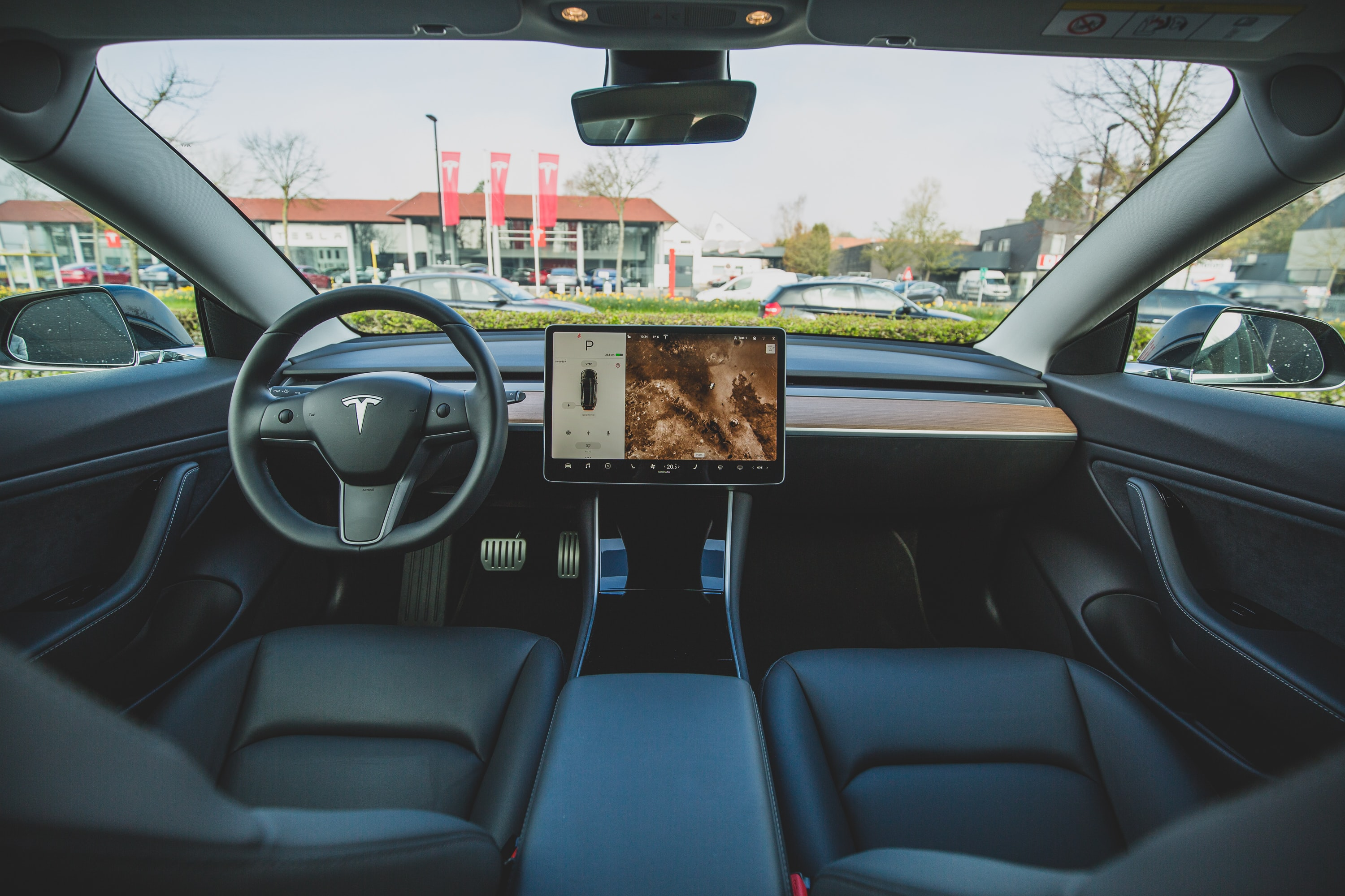 Interior of a Tesla showing the dashboard and touch screen interface