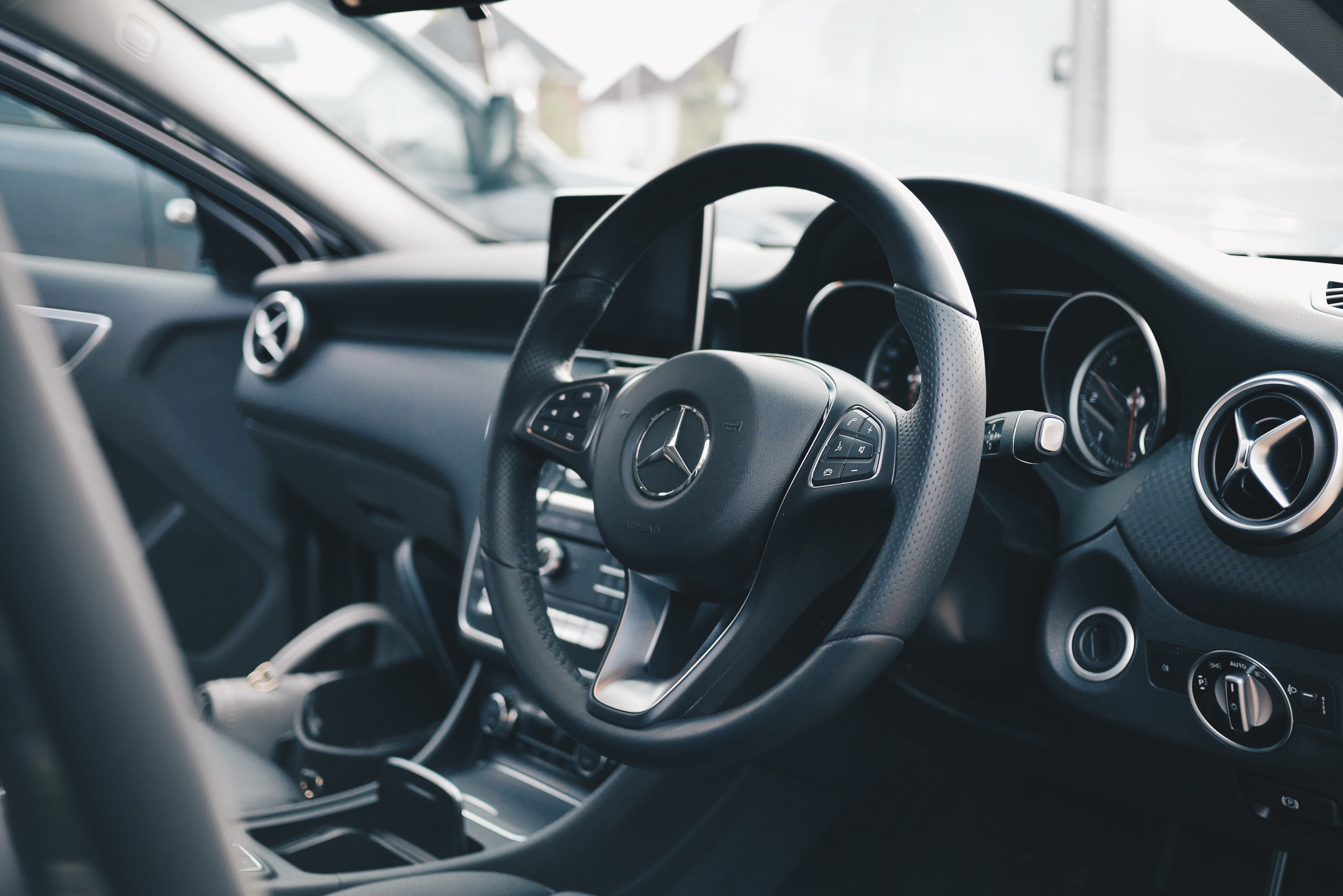 Dashboard and steering wheel of a Mercedes car